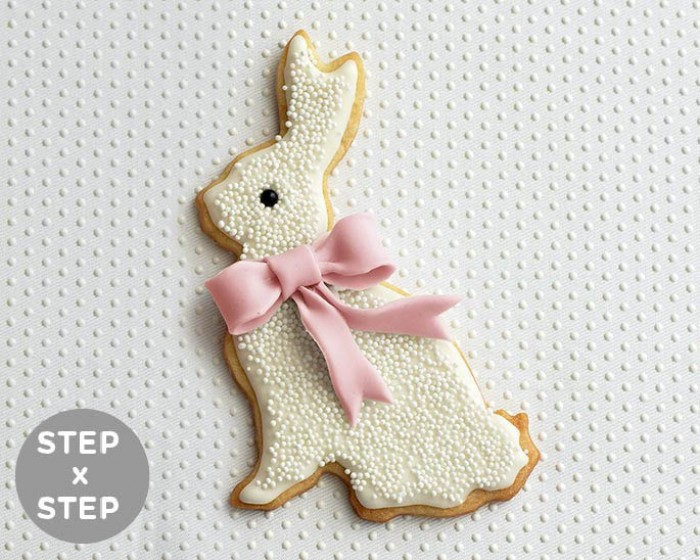 This non pareil covered Easter Bunny cookie is a modern twist on a classic treat. See how to make them in our DIY step by step photo tutorial. Complete with recipes and supplies | Shop Cakegirls