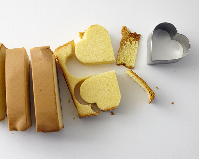 Cutting out conversation heart cakes.