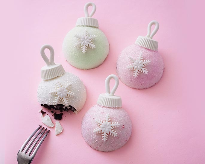 Our step by step photo tutorial shows you how to make these adorable and easy ornament cakes for Christmas dessert!