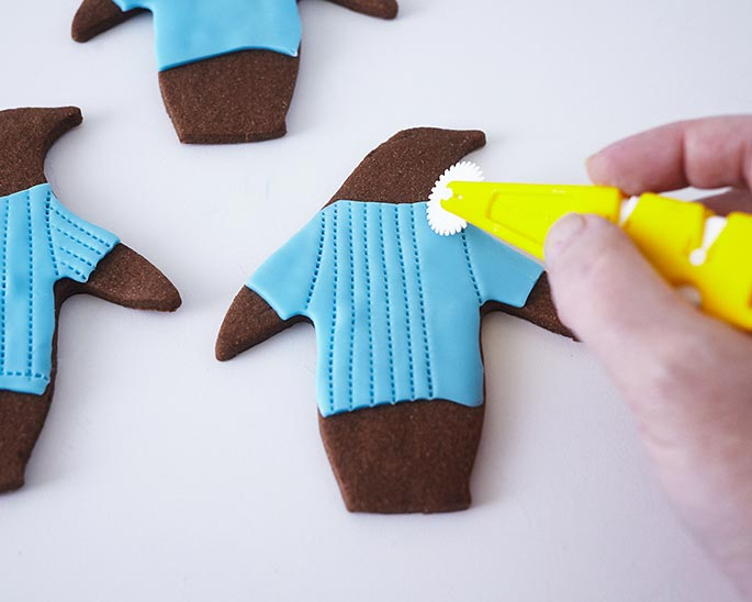 These Penguin in Penguin Sweater Cookies will be the Christmas cookie hit this season.