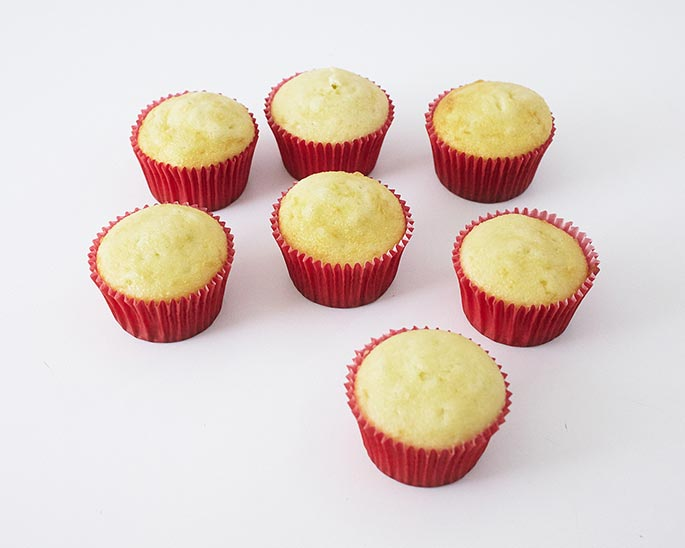 Vanilla Cupcakes Baked in Red Baking Cups