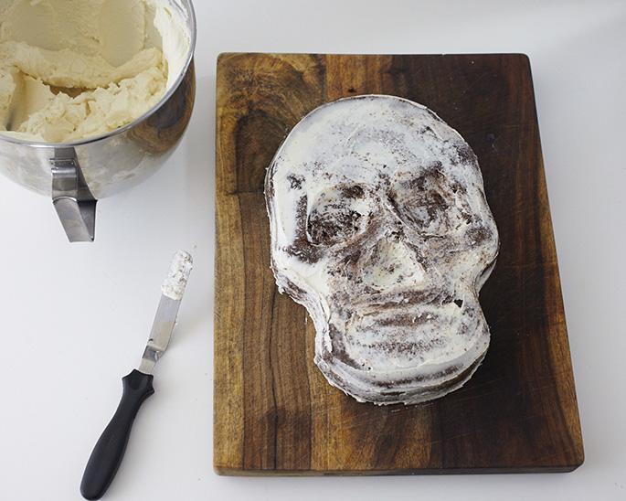 Crumbcoating a skull cake