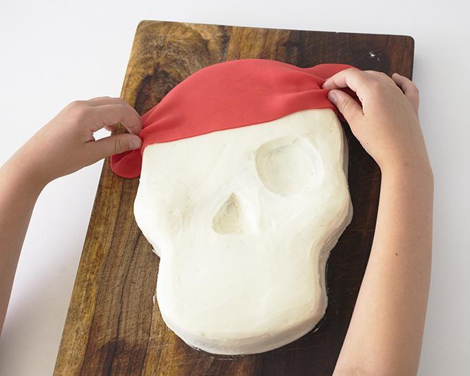 Adding fondant to a pirate cake