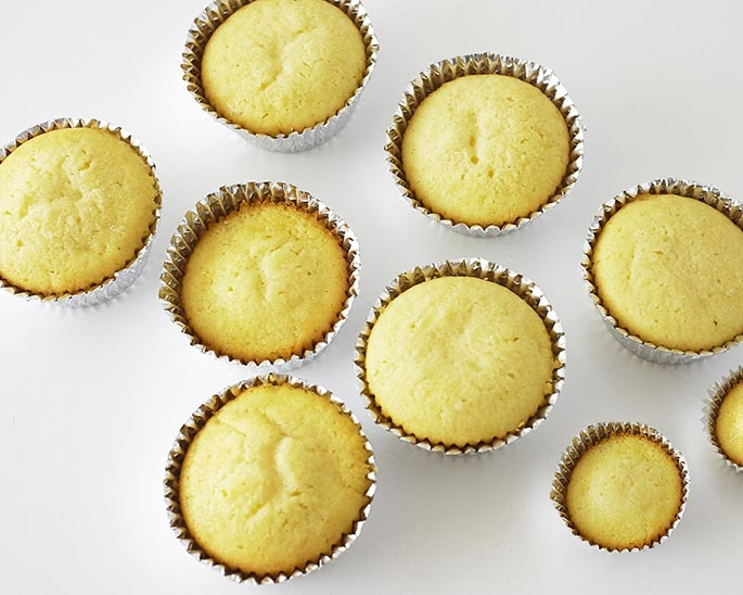 Start by baking your cupcakes in silver foil liners